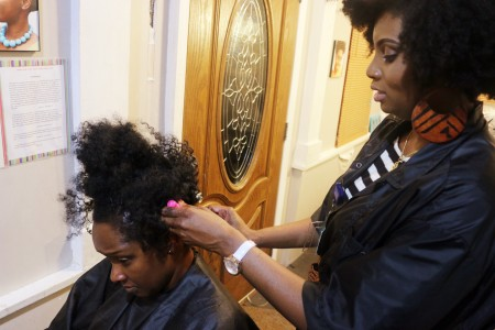 Vasia Archer Founder/Owner of Butterfly Naturals installing my crochet braids. I call her the Natural Hair Guru